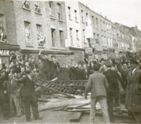 Anti-fascists round one of the barricades in Cable Street that stopped the fascists marching on 4th October 1936